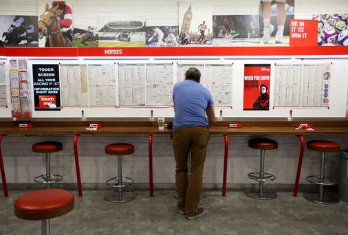 Ladbrokes, above, and Coral announced plan last summer. Photo: Bloomberg