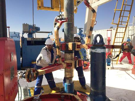 A drill crew making up pipe at Petroceltic's facility in Algeria