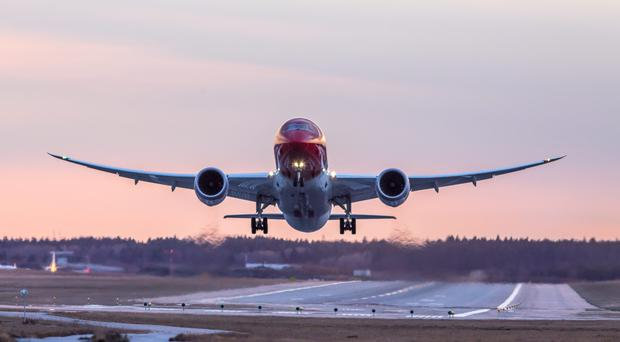 A Norwegian Airlines International flight takes off