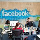 Staff at work inside the Facebook international office in Dublin's city centre.