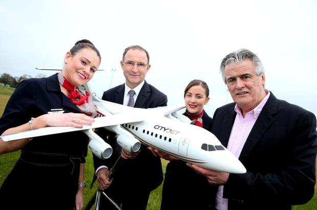 CityJet crew member Fiona Phelan (left)with Martin O'Neill, Irish team manager; and CityJet crew member Lisa O'Brien with Pat Byrne, executive chairman, CityJet (right) at the announcement that CityJet has been appointed Official Airline Partner of the FAI