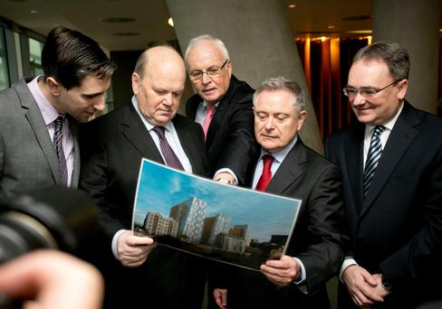 Outgoing Minister of State at the Department of Finance Simon Harris, outgoing Minister for Finance Michael Noonan, NAMA chairman Frank Daly, outgoing Minister for Public Expenditure Brendan Howlin, and Brendan McDonagh, NAMA chief executive