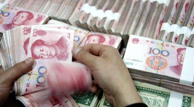 A staff member counts money at a branch of Industrial and Commercial Bank of China Limited (ICBC). Photo: Getty Images