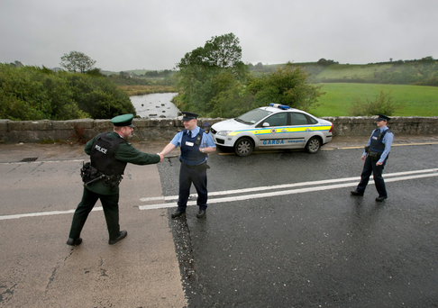 A file photograph from 2011 of interaction between the PSNI and gardai on the border. Photo: Mark Condren