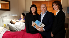 Lorraine and Careena Galligan with Sean Gallagher at the beauty school. Photo: Gerry Mooney