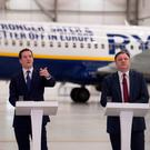 UK Chancellor of the Exchequer George Osborne, centre, is joined by former adversaries Ed Balls, right, and Vince Cable, in the Ryanair hangar at Stansted Airport, where he said that Britain is 'stronger, safer and better off' in the European Union