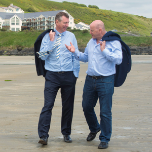 Des O'Dowd with Sean Gallagher on the beach at Inchydoney. Photo: Michael MacSweeney