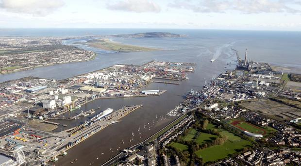 Where the murky arteries of Dublin City meet the Irish Sea — a view from the air of Dublin Port, Ringsend and Irishtown, while out to the north are Bull Island and Howth Head. Top right, Eamonn O'Reilly, the chief executive officer at Dublin Port. Portrait: Kyran O'Brien