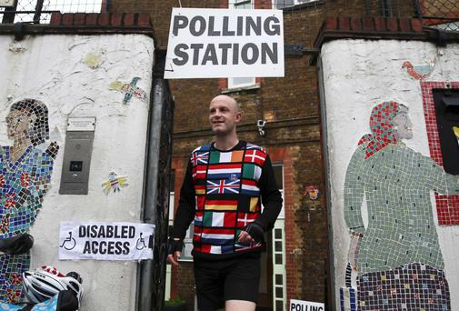 A man wearing a Europe-themed cycling jersey arrives to vote at a polling station for the referendum on the European Union in north London yesterday. Photo: Reuters