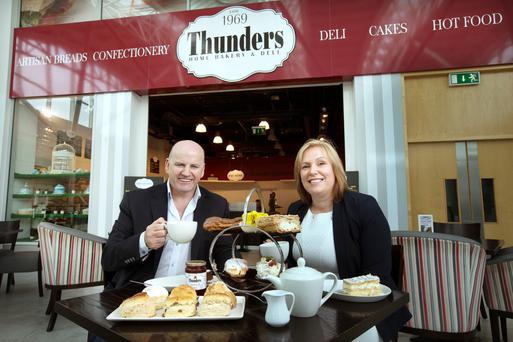 Sean Gallagher enjoys afternoon tea with Sinead Heffernan of Thunders home bakery and deli in Liffey Valley. Photo: Tony Gavin