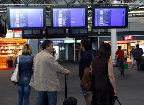 Passengers check flight information at Marseille-Provence Airport last month amid a strike by air traffic controllers