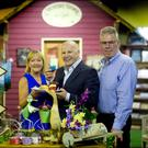 Sean Gallagher, centre, with Shirley and Henry O'Kelly of Timbertrove Country Store. Photo: David Conachy