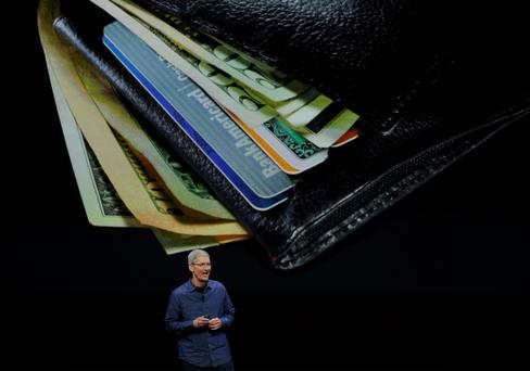 Ceo Tim Cook launches Apple Pay in 2014: 'If Apple pays the €13bn or more, it will be able to claim a tax credit in the US'