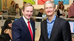 Taoiseach Enda Kenny and Apple CEO Tim Cook on a visit to Apple's Cork facility in 2014.