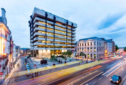 The Central Bank's Dame Street HQ, designed by the late Sam Stephenson, is being sold with two other properties by Lisney
