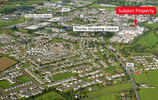 The well-located 0.4 acre site is zoned retail and commercial