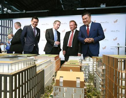 Ballymore Group chairman and CEO Sean Mulryan, centre, Ballymore's UK managing director John Mulryan, left, and Oxley Holdings chairman Ching Chiat Kwong inspect a model of Dublin Landings, at the development's launch last Thursday morning at the CHQ in Dublin's docklands