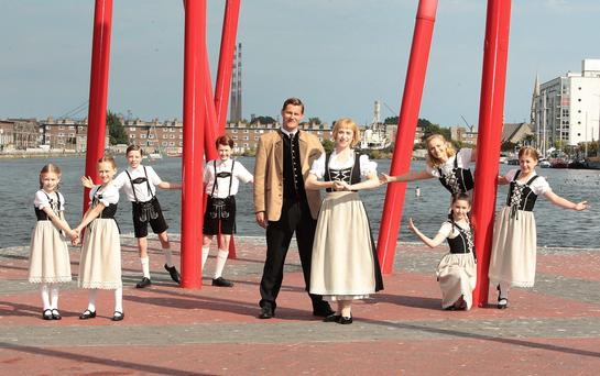 Danielle Hope in the iconic role of Maria von Trapp, with Steve Houghton as Captain von Trapp and 'The Sound of Music' cast members, outside the Bord Gáis Energy Theatre. The musical helped boost the theatre's operating profits