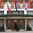 A doorman passes the main entrance to Claridge's hotel in Londo