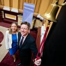Brian Caulfield, managing director, Draper Esprit, rings the bell at the IPO in Dublin, watched by Orla O'Gorman, head of equity at the Irish Stock Exchange