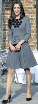 Britain's Duchess of Cambridge wearing one of the creations by Irish fashion designer Orla Kiely