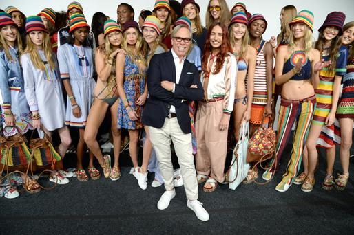 Tommy Hilfiger and models pose backstage at Tommy Hilfiger Women's Spring 2016 during New York Fashion Week