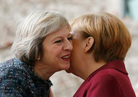 Britain's prime minister Theresa May is welcomed by German Chancellor Angela Merkel to the chancellery in Berlin yesterday. Photo: Reuters