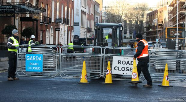 The street outside the Dáil being sealed off ahead of a protest – the country has seen a slew of public demonstrations in recent years as people voice their anger at various issues