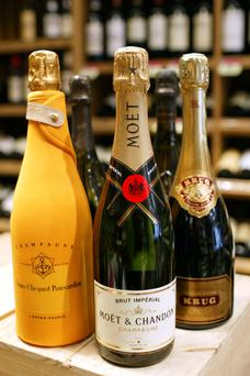 From left to right: a Veuve Clicquot, a Moet et Chandon, and a Krug Champagne bottles in a Nicolas wine store, in Paris, France, on September 15th, 2004.