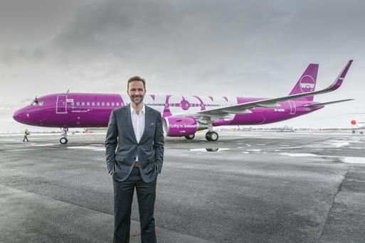 Wow Air chief executive Skuli Mogensen with one of its planes