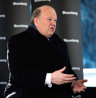 Finance Minister Michael Noonan speaks to the media at the World Economic Forum in Davos. Switzerland, last week. Photo: Simon Dawson/Bloomberg
