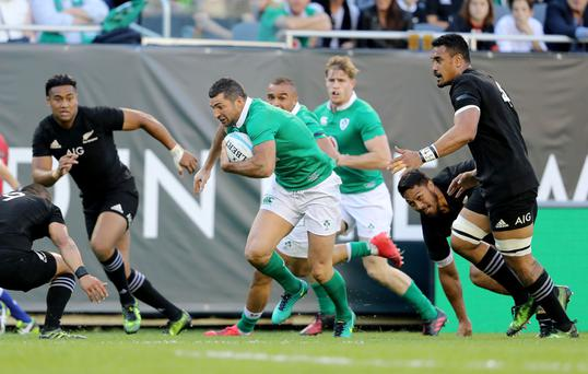 Ireland's Rob Kearney takes on the All Blacks defence in the famous victory in Chicago. The match coverage and other exclusive content helped Eir lift its sports viewers to more than 200,000