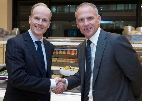 Tesco ceo Dave Lewis (right) and Booker ceo Charles Wilson shake hands on the deal to create a UK food giant. Photo: PA