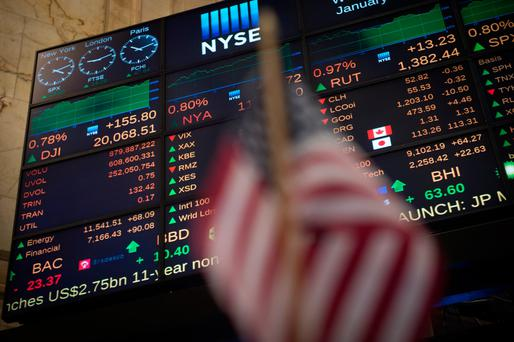 A video board shows the Dow Jones closing above 20,000 for the first time last Wednesday, extending a stocks rally that followed US President Donald Trump'selection. Photo: Getty