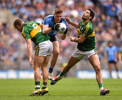 Dublin's James Small is tackled by Peter Crowley, left, and Bryan Sheehan of Kerry
