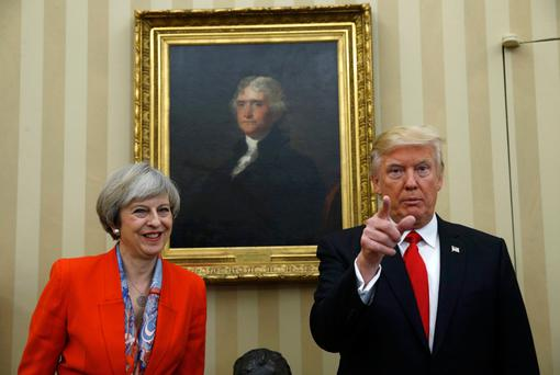 US President Donald Trump meets with British Prime Minister Theresa May in the White House Oval Office in Washington. Photo: Reuters
