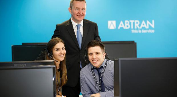 Michael Fitzgerald, ceo of Abtran, with Abtran staff Andrea Woods and Anthony Foley