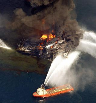 The Deepwater Horizon oil rig is seen burning in the aftermath of the explosion