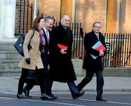 Ray Hernan, (second left) acting ceo of Bus Éireann, and officials arrive at an Oireachtas Transport Committee meeting at Leinster House. Photo: Tom Burke