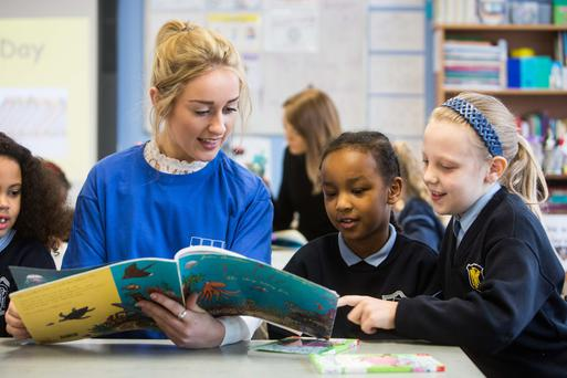 Anna O'Sullivan from KPMG with pupils Munirah Mahamed and Nikola Wowak at North Presentation Primary School in Cork on World Book Day as KPMG donated books. Photo: Darragh Kane
