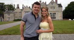 Brian O'Driscoll and Amy Huberman relax in the grounds of Lough Rynn Castle Hotel in Co Leitrim the day after their wedding. Photo: PA