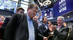 Ardagh chairman Paul Coulson rings the opening bell on the New York Stock Exchange as the packaging giant's shares are listed. Photo: AP Photo/Richard Drew