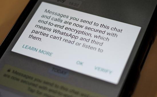 A security update message is seen on a Whatsapp message – the issue of online security has become a large concern on Wall Street