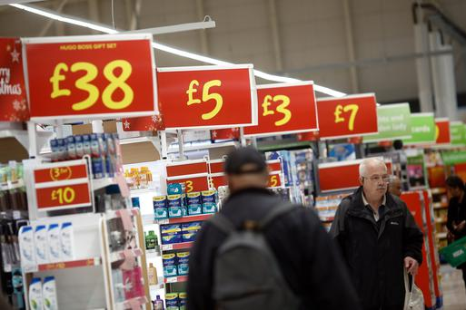 While shoppers will be happy to have a few extra coins in their pockets, falling prices present a challenge for retailers. Photo: Bloomberg