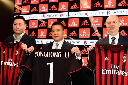 Chinese businessman and new owner of AC Milan, Yonghong Li (centre) poses with Italian businessman Marco Fassone (right) and Rossoneri Sport Investment Lux representative David Han Li at a press conference over the sale of the Italian football club. Photo: AFP/Getty Images