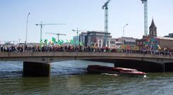 Water charge protesters on the march at Matt Talbot Bridge Photo: Colin O'Riordan