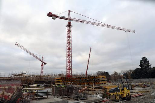 With the office-building boom apparent in Dublin, the rarer sight of cranes being used in a residential development in the city. Photo: Bloomberg
