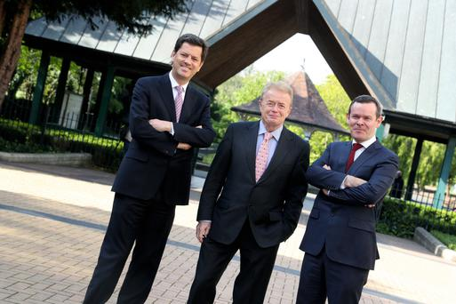 CEO Tony Smurfit, non-executive director Liam O'Mahony and chief financial officer Ken Bowles at the Smurfit Kappa GroupAGM. Photo: Maxwells