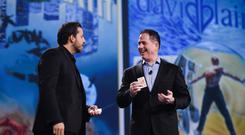Michael Dell, seen here on stage with magician David Blaine, gets ready to pull off his next trick following Dell's multi-billion dollar merger with EMC