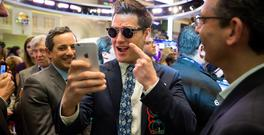 Matthew Kobach, manager of digital and social media at the New York Stock Exchange, takes a selfie wearing a pair of Snapchat Spectacles on the floor of the NYSE during the company's IPO in March
